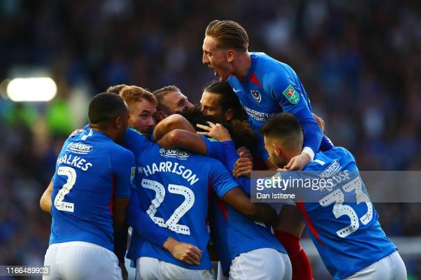 Ellis Harrison of Portsmouth celebrates with teammates after scoring the opening goal during the Carabao Cup First Round match between Portsmouth and...
