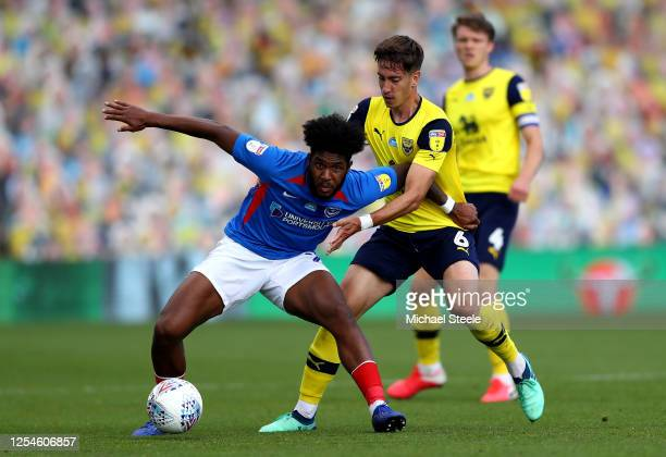 Ellis Harrison of Portsmouth holds off Alex Gorrin of Oxford United during the Sky Bet League One Play Off Semifinal 2nd Leg match between Oxford...