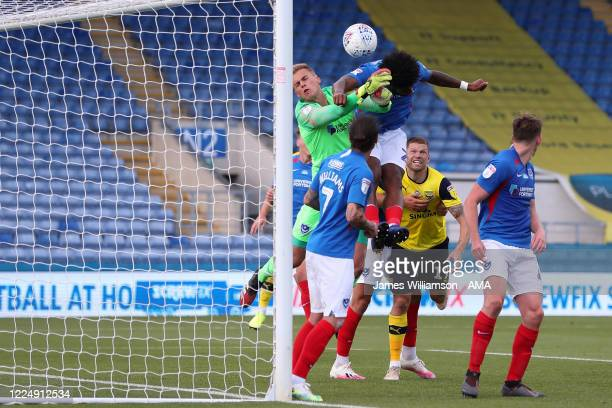 Ellis Harrison of Portsmouth scores an own goal to make it 1-1 during the Sky Bet League One Play Off Semi-final 2nd Leg match between Oxford United...