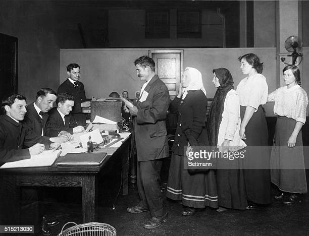 Ellis Island: New arrivals line up to have their papers examined. Undated photograph. BPA2# 2515