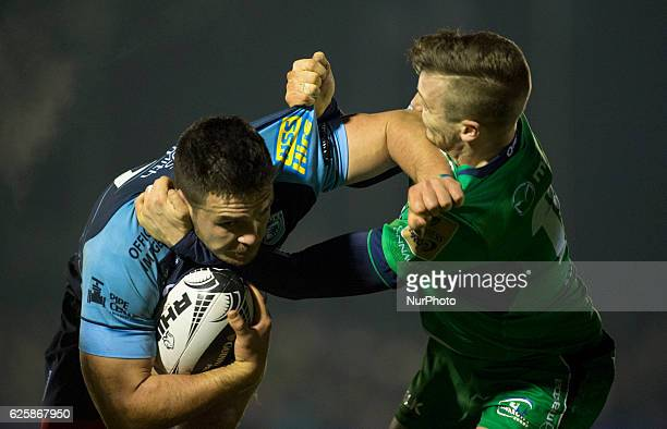 Ellis Jenkis of Cardiff tackled by Jack Carty of Connacht during the Guinness PRO12 Round 9 match between Connacht Rugby and Cardiff Blues at the...