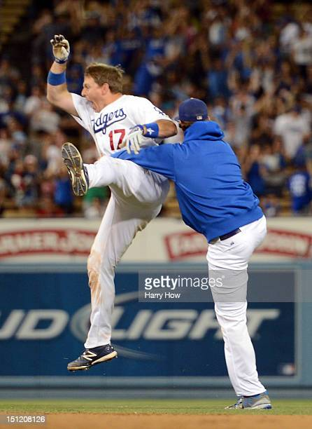 J Ellis of the Los Angeles Dodgers celebrates his game winning single with Clayton Kershaw for a 43 win over the San Diego Padres during the 11th...