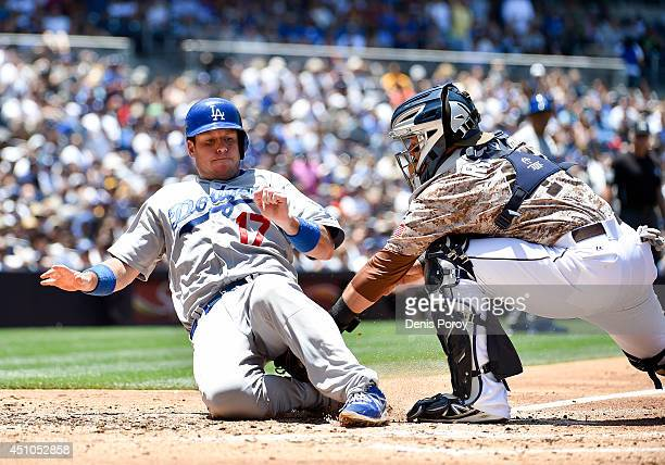 J Ellis of the Los Angeles Dodgers is tagged out at the plate by Rene Rivera of the San Diego Padres during the second inning of a baseball game at...
