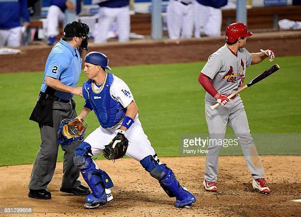 J Ellis of the Los Angeles Dodgers looks for a wild pitch behind Aledmys Diaz of the St Louis Cardinals allowing Kolten Wong to score to trail 74...