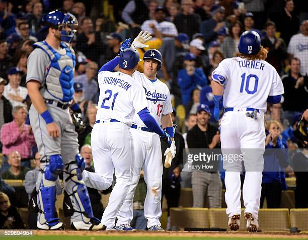 J Ellis of the Los Angeles Dodgers reacts to the two run homerun of Trayce Thompson with Justin Turner as Kevin Plawecki of the New York Mets looks...