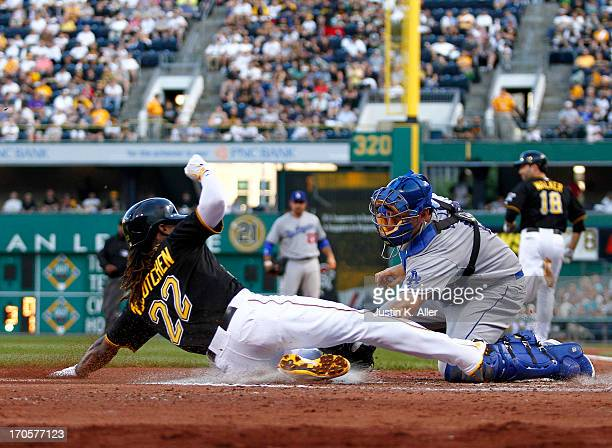 J Ellis of the Los Angeles Dodgers tags out Andrew McCutchen of the Pittsburgh Pirates in the third inning during the game on June 14 2013 at PNC...