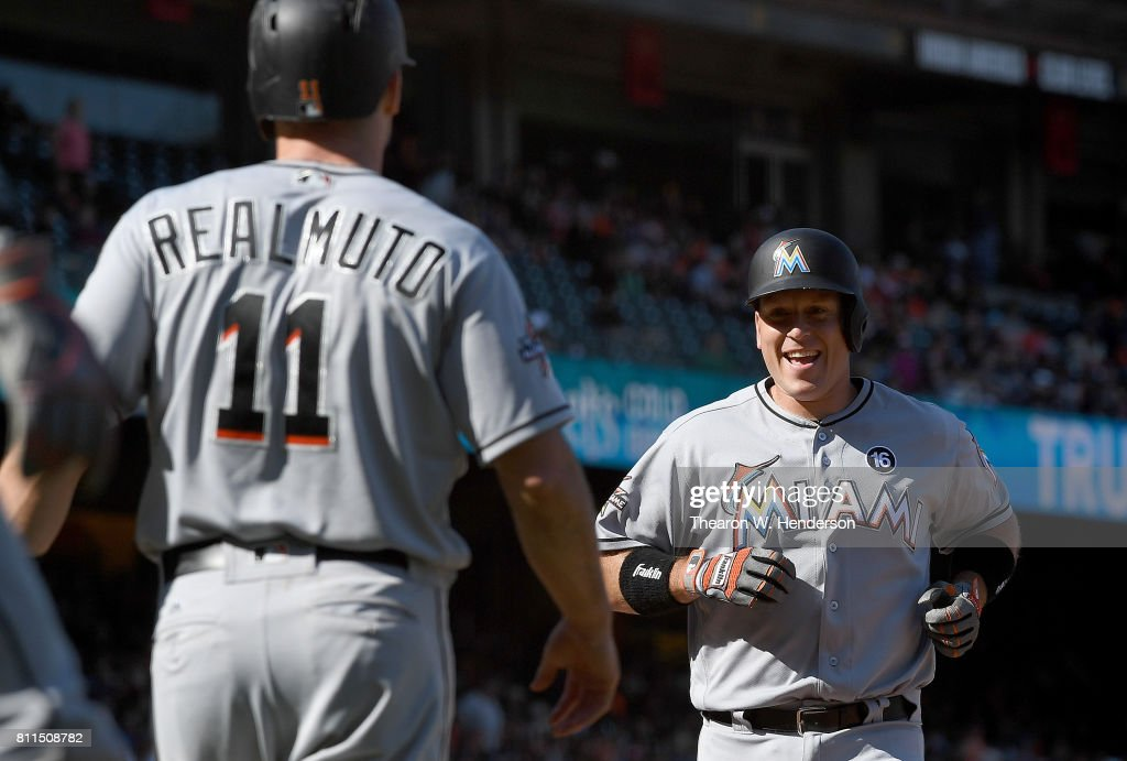 A.J. Ellis #17 of the Miami Marlins and J.T. Realmuto #11 celebrates after Ellis hit a two-run homer against the San Francisco Giants in the top of the 11th inning at AT&T Park on July 9, 2017 in San Francisco, California. The Marlins won the game 10-8.