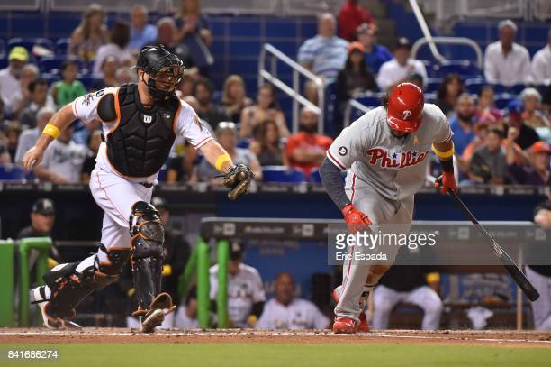 J Ellis of the Miami Marlins attempts to tag Jorge Alfaro of the Philadelphia Phillies after striking out in the second inning during the game at...