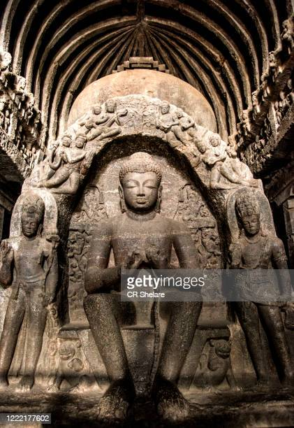 ellora cave no.10, a 7th-century buddhist chaitanya hall, seated buddha sculpted with hands in the dharmachakra mudra, aurangabad, maharashtra, india - ellora stock pictures, royalty-free photos & images