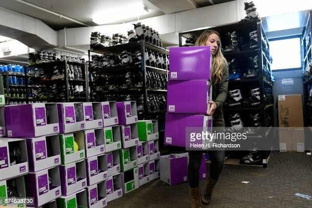 NEDERLAND CO NOVEMBER 9 Elly Brown rental and retail manager and buyer moves helmets to put on display inside of Timbers Lodge at Eldora ski area on...
