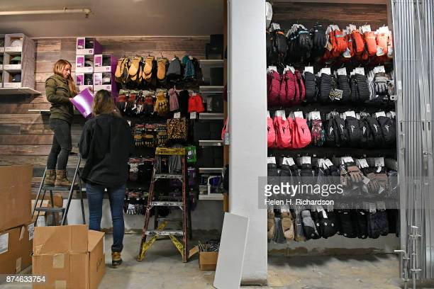 NEDERLAND CO NOVEMBER 9 Elly Brownleft rental and retail manager and buyer and Gabby Grenier right retail supervisor work on displays inside of...