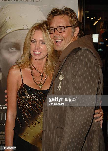 Elly Castle and husband John Schneider during Warner Bros Pictures' North Country Los Angeles Premiere Arrivals at Grauman's Chinese Theatre in...