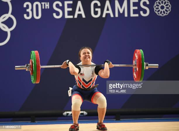 Elly Engelbert of Malaysia competes in the women's 55kg weightlifting clean and jerk event at the SEA Games in Manila on December 2, 2019.