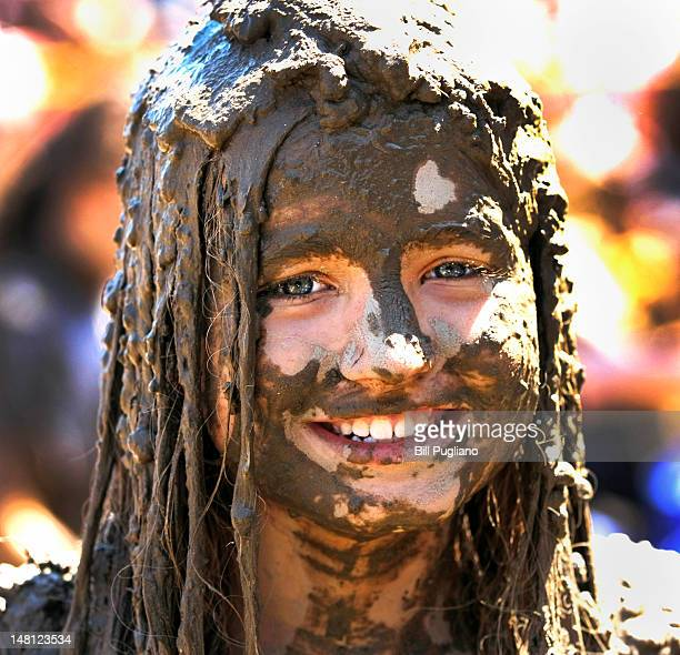 Elly Kuzma age 10 of Woodhaven Michigan is covered with mud while playing in a giant lake of mud at the 25th annual 'Mud Day' July 10 2012 in...