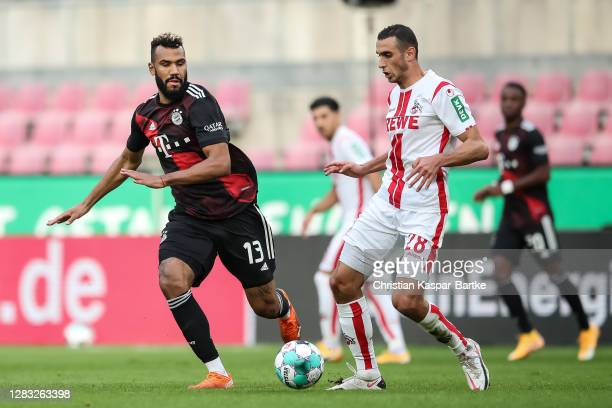 Ellyes Skhiri of 1FC Koeln is challenged by Eric Maxim ChoupoMoting of FC Bayern Muenchen during the Bundesliga match between 1 FC Koeln and FC...