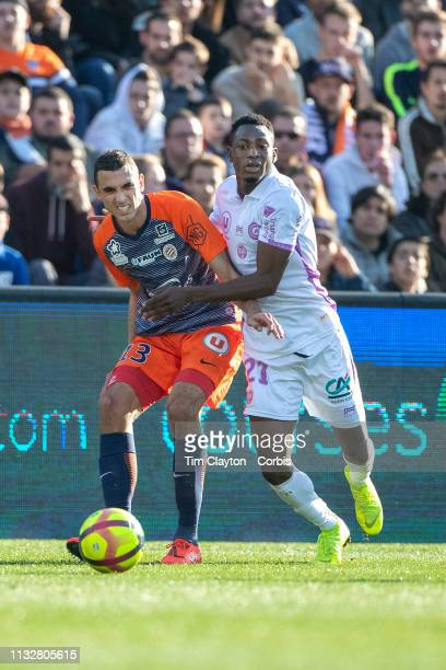 Ellyes Skhiri of Montpellier and Baba Rahman of Stade de Reims challenge for the ball during the Montpellier Vs Stade de Reims French Ligue 1 regular...