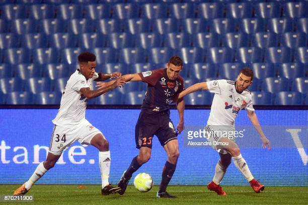 Ellyes Skhiri of Montpellier and Bongani Zungu and Oualid El Hajjam of Amiens during the Ligue 1 match between Montpellier Herault SC and Amiens SC...