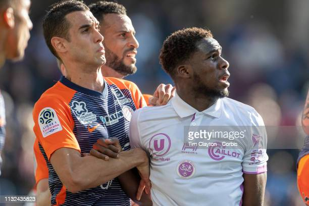 Ellyes Skhiri of Montpellier and Boulaye Dia of Stade de Reims jostle for position at a corner kick during the Montpellier Vs Stade de Reims French...