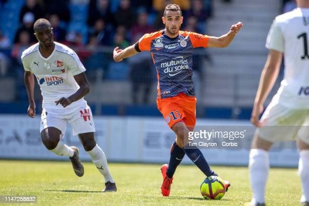 Ellyes Skhiri of Montpellier defended by Sehrou Guirassy of Amiens during the Montpellier Vs SC Amiens French Ligue 1 regular season match at Stade...