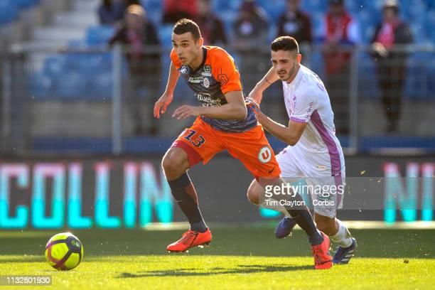 Ellyes Skhiri of Montpellier defended by Xavier Chavalerin of Stade de Reims during the Montpellier Vs Stade de Reims French Ligue 1 regular season...