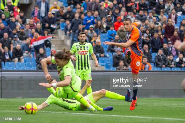 Ellyes Skhiri of Montpellier scores his sides second goal shooting past Mateo Pavlovic of Angers during the Montpellier V Angers French Ligue 1...
