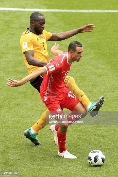 Ellyes Skhiri of Tunisia battles with Romelu Lukaku of Belgium during the 2018 FIFA World Cup Russia Group G match between Belgium and Tunisia at...