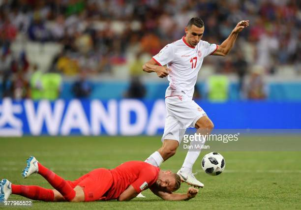 Ellyes Skhiri of Tunisia controls the ball as Jordan Henderson of England goes down during the 2018 FIFA World Cup Russia group G match between...