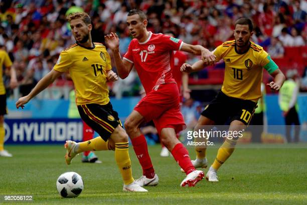 Ellyes Skhiri of Tunisia holds off Dries Mertens and Eden Hazard of Belgium during the 2018 FIFA World Cup Russia group G match between Belgium and...