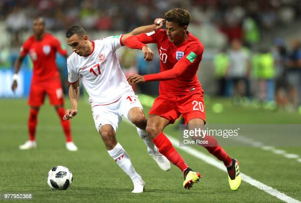 Ellyes Skhiri of Tunisia is tackled by Dele Alli of England during the 2018 FIFA World Cup Russia group G match between Tunisia and England at...