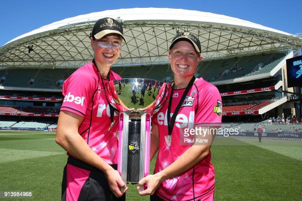 Ellyse Perry and Alyssa Healy of the Sixers pose with the trophy after winning the Women's Big Bash League final match between the Sydney Sixers and...