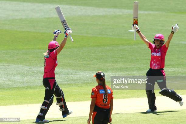 Ellyse Perry and Ashleigh Gardner of the Sixers celebrate winning the Women's Big Bash League final match between the Sydney Sixers and the Perth...