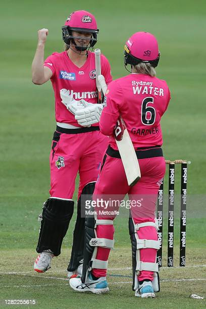 Ellyse Perry and Ashleigh Gardner of the Sixers smile celebrate victory during the Women's Big Bash League WBBL match between the Sydney Sixers and...