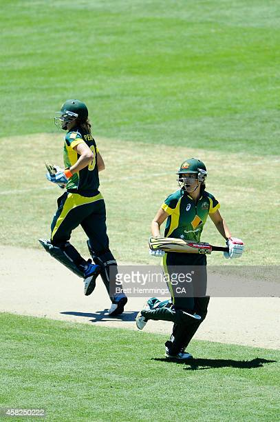 Ellyse Perry and Jess Jonassen of Australia run between the wicket during the women's International Twenty20 match between Australia and the West...