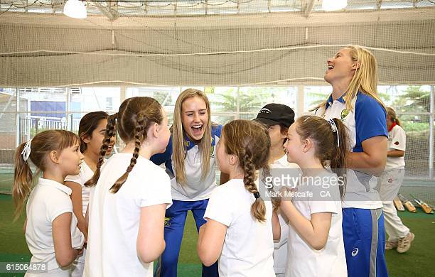 Ellyse Perry and Meg Lanning laugh with young female cricket players during a Cricket Australia Commonwealth Bank Sponsorship Media Announcement at...