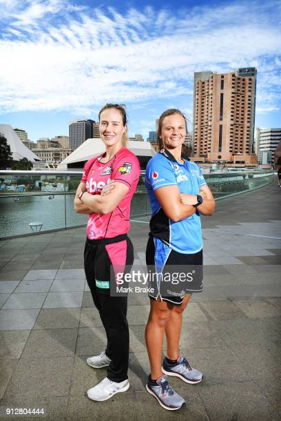 Ellyse Perry captain of the Sydney Sixers and Suzie Bates captain of the Adelaide Strikers pose on theAdelaide Footbridge during the Big Bash League...