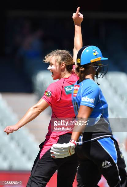 Ellyse Perry captain of the Sydney Sixers celebrates after taking the wicket of Sophie Devine of the Adelaide Strikers during the Women's Big Bash...