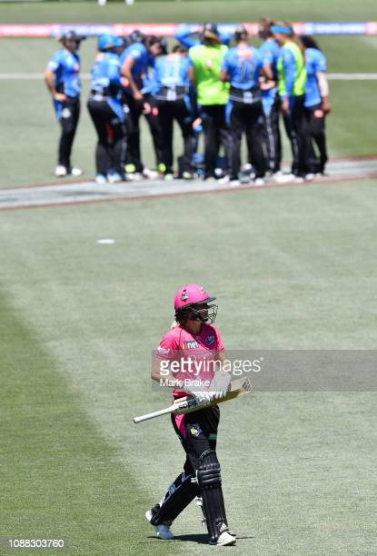 Ellyse Perry captain of the Sydney Sixers leaves the ground after being caught by Suzie Bates of the Adelaide Strikers during the Women's Big Bash...