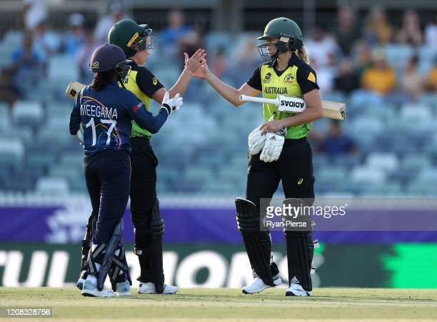 Ellyse Perry of Australia and Meg Lanning of Australia celebrates after scoring the winning runs during the ICC Women's T20 Cricket World Cup match...