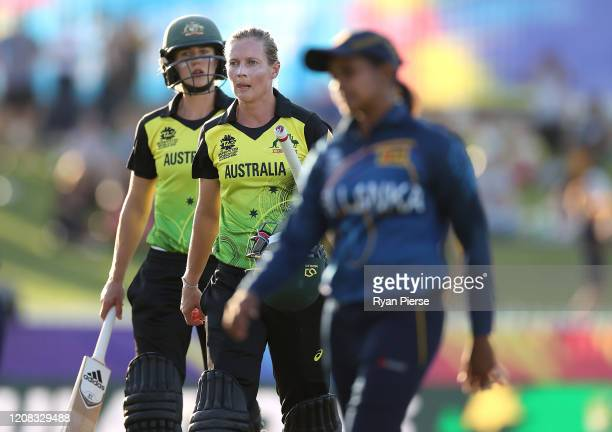 Ellyse Perry of Australia and Meg Lanning of Australia walk from the ground after scoring the winning runs during the ICC Women's T20 Cricket World...