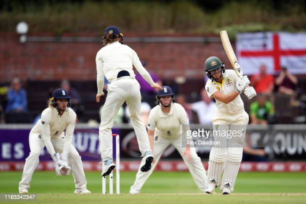 Ellyse Perry of Australia bats as Amy Jones of England jumps out the way and Sarah Taylor and Anya Shrubsole of England look on during Day Four of...