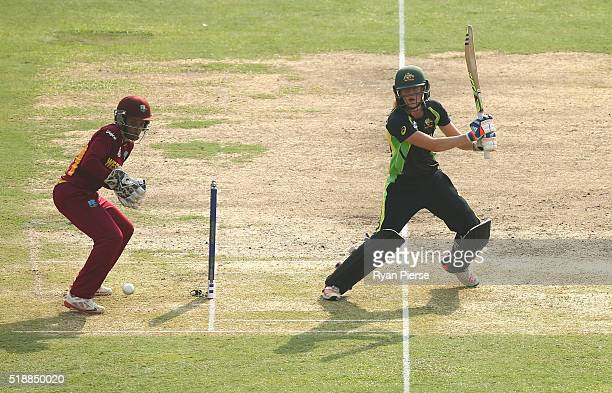 Ellyse Perry of Australia bats as Merissa Aguilleira of the West Indies keeps wicket during the Women's ICC World Twenty20 India 2016 Final match...