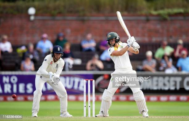 Ellyse Perry of Australia bats watched on by Amy Jones of England during Day Four of the Kia Women's Test Match between England Women and Australia...