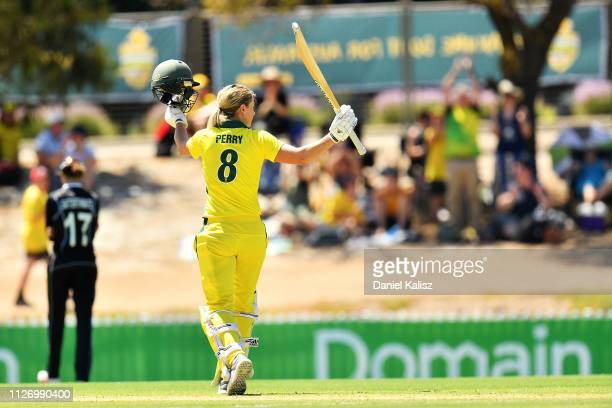 Ellyse Perry of Australia celebrates after reaching her century during game two of the One Day International Series between Australia and New Zealand...