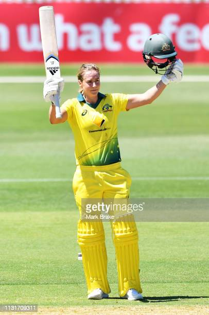 Ellyse Perry of Australia celebrates after reaching her maiden one day century during game two of the One Day International Series between Australia...