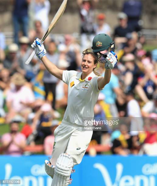 Ellyse Perry of Australia celebrates her century during day three of the Women's Test match between Australia and England at North Sydney Oval on...