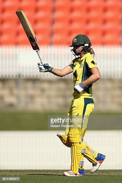 Ellyse Perry of Australia celebrates her half century during the women's one day international match between the Australia Southern Stars and South...