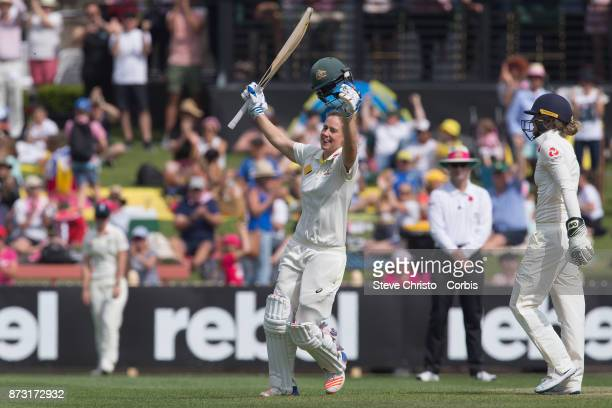 Ellyse Perry of Australia celebrates scoring a century during day three of the Women's Test match between Australia and England at North Sydney Oval...