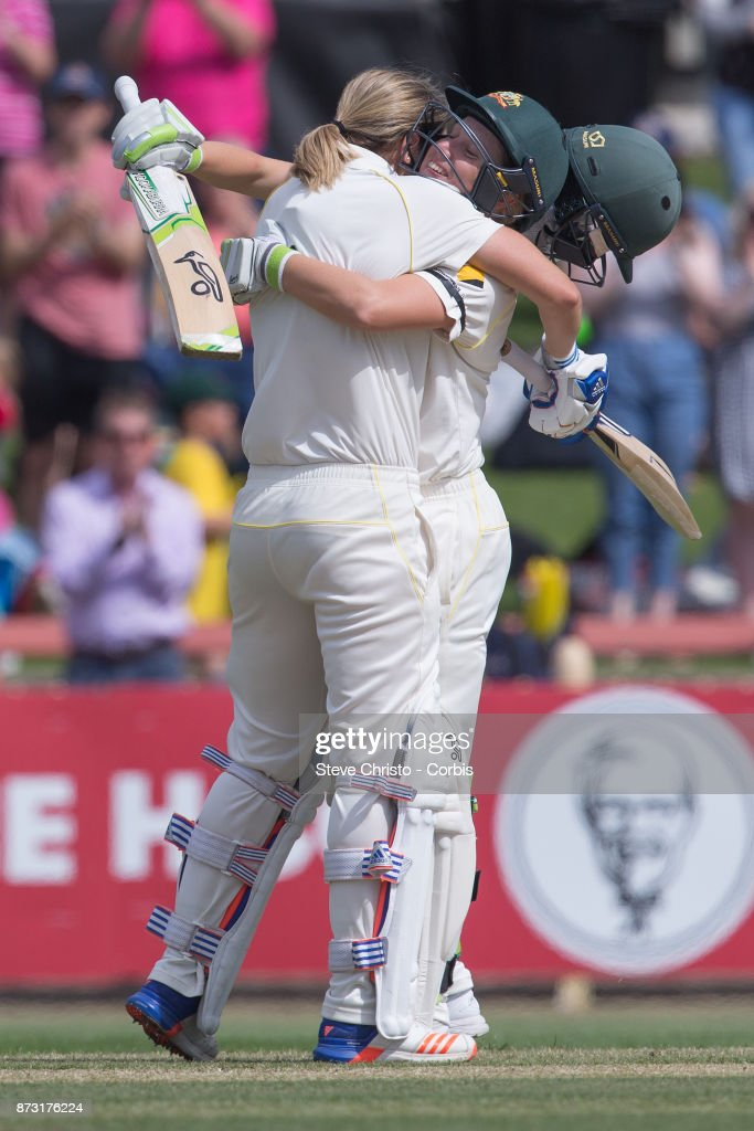 Ellyse Perry of Australia celebrates scoring a century with teammate Alyssa Healy during day three of the Women's Test match between Australia and England at North Sydney Oval on November 11, 2017 in Sydney, Australia.