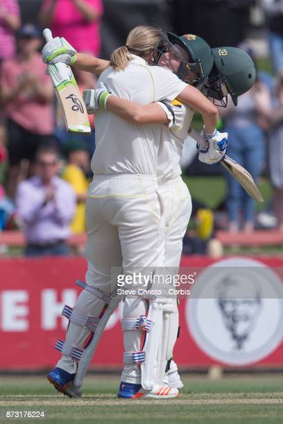 Ellyse Perry of Australia celebrates scoring a century with teammate Alyssa Healy during day three of the Women's Test match between Australia and...