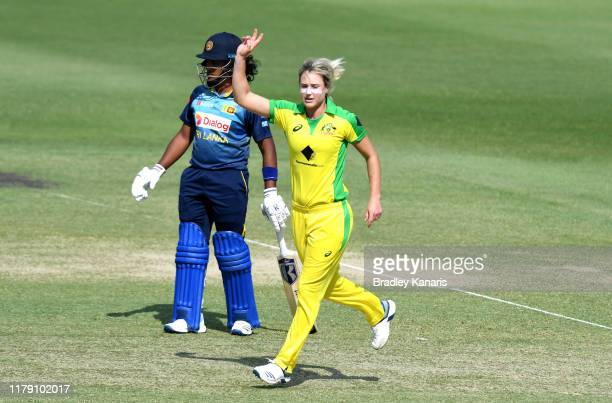 Ellyse Perry of Australia celebrates taking the wicket of Chamari Athapaththu of Sri Lanka during game one of the Women's One Day International...